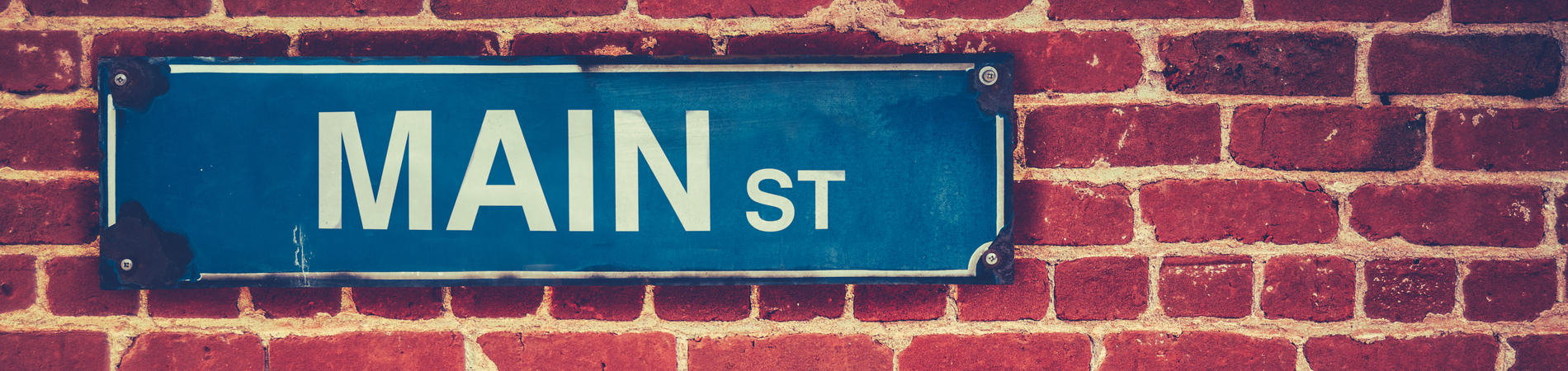 main_street_sign_on_brick_wall